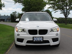 2013 BMW X1 xDrive35i M-Sport Alpine White headlights on
