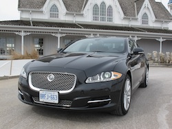 2013 Jaguar XJ 3.0L AWD Black front view with headlights and grille