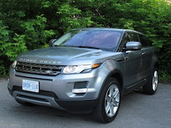 2013 Range Rover Evoque Coupe Metal Gray front view with headlights trees background