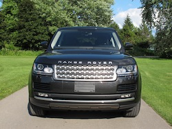 2013 Range Rover V8 Supercharged Black front view on road grass