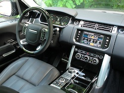 2013 Range Rover V8 Supercharged Black interior dashboard with steering wheel shown