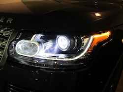 2013 Range Rover V8 Supercharged Black front headlights with camera lens