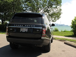 2013 Range Rover V8 Supercharged Black rear view next to beach and lake ontario