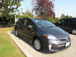 2013 Toyota Prius Plugin Hybrid Gray front view charging at a charging station