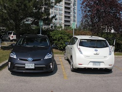 2013 Toyota Prius Plugin Hybrid Gray and nissan leaf white