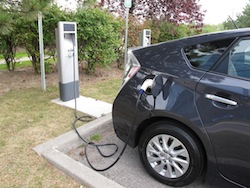 2013 Toyota Prius Plugin Hybrid Gray plugged in at a charging station