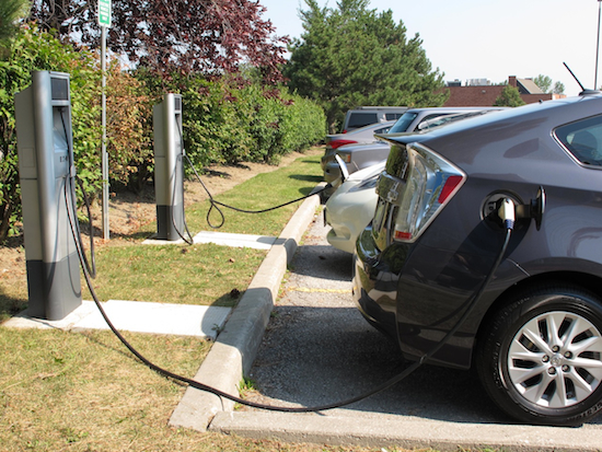 2013 Toyota Prius Plugin Hybrid Gray at a charging station
