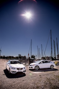 BMW 228i Honda Civic Si White basking in the sun