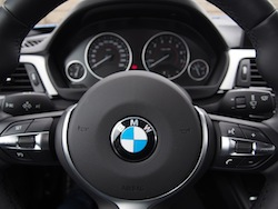 2014 BMW 435i xDrive Estoril Blue Metallic Gray steering wheel focused with gauges in the background