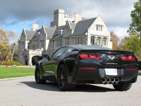 2014 Chevrolet Corvette C7 Stingray Black rear side view with castle
