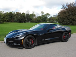 2014 Chevrolet Corvette C7 Stingray Black side view with red calipers