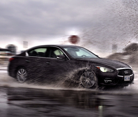 2014 Infiniti Q50 AWD Brown drifting through puddles water
