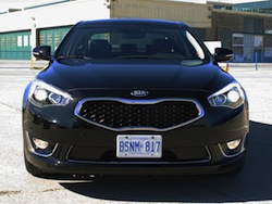 2014 Kia Cadenza black front view grille on a track