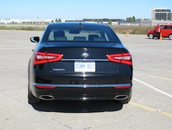 2014 Kia Cadenza black rear view exhausts and taillights