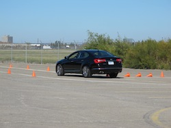 2014 Kia Cadenza black on a track slalom
