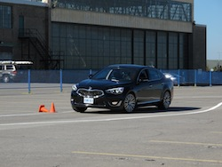 2014 Kia Cadenza black drifting in a slalom