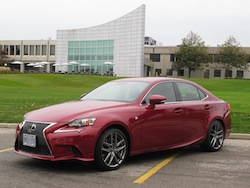 2014 Lexus IS350 F-Sport RWD Red front side view in front of lexus headquarters