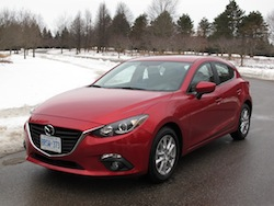 2014 Mazda 3 Sport GS Soul Red front side view 2