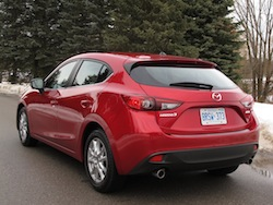 2014 Mazda 3 Sport GS Soul Red rear side view exhausts