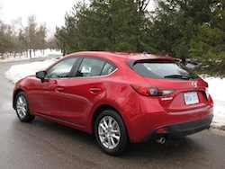2014 Mazda 3 Sport GS Soul Red rear side hatchback view