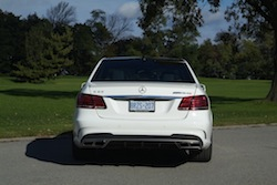 2014 Mercedes E63 AMG S White rear view with exhausts and taillights