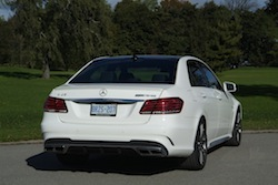 2014 Mercedes E63 AMG S White rear side view exhausts badge