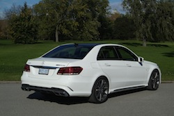 2014 Mercedes E63 AMG S White rear side view exhausts