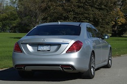 2014 Mercedes-Benz S550 Silver rear view taillights exhaust grass background