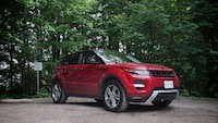 2014 Range Rover Evoque 5-door Firenze Red front view in the forest