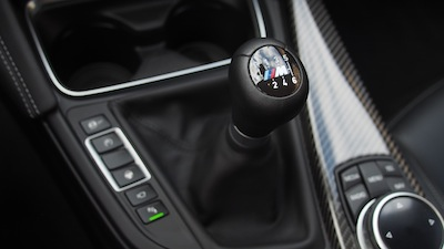 2015 BMW M4 Coupe Austin Yellow manual gear shifter
