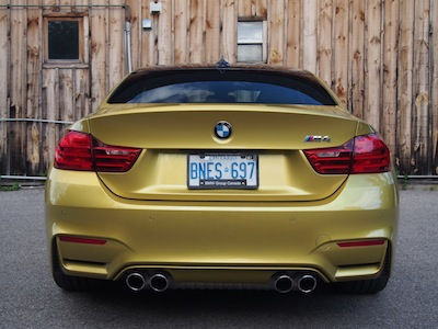 2015 BMW M4 Coupe Austin Yellow exhaust taillights
