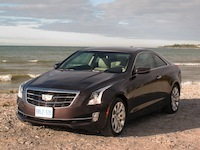 2015 Cadillac ATS Coupe brown view on beach