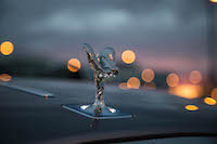 Rolls-Royce Wraith uplit spirit of ecstasy hood ornament at sunset