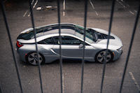 2017 BMW i8 side view behind bars